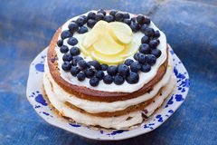 Lemon blueberry naked cake with blueberries on the top and mascarpone butter frosting Stock Image