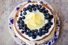Lemon blueberry naked cake with blueberries on the top and mascarpone butter frosting Stock Images