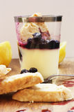Lemon & blueberry posset with shortbread Stock Photography