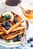 Lemon blueberry waffles with honey Stock Photos
