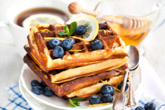 Lemon blueberry waffles with honey Stock Photo