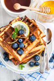 Lemon blueberry waffles with honey Royalty Free Stock Photo