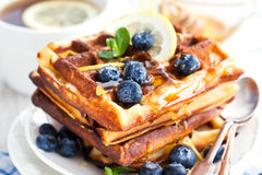 Lemon blueberry waffles with honey Stock Image