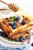 Lemon blueberry waffles with honey Royalty Free Stock Image