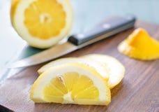 Lemon on board Stock Image