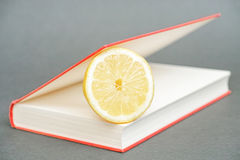 Lemon in a book Royalty Free Stock Image