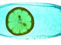 Lemon in a bottle. Green lemon in a bottle of jelly Stock Photography