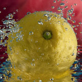 Lemon between bubbles Royalty Free Stock Image