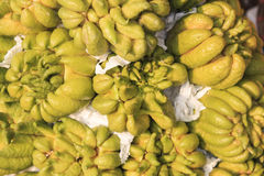 Lemon Buddha's hand (Citrus medica var. sarcodactylis) for sale in a market of Hanoi, Vietnam Stock Image