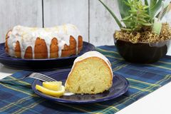 Lemon Bundt Pound Cake, sliced and whole. Royalty Free Stock Photography