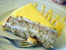 Lemon cake. Slice of lemon with whipped cream and lemon cream Royalty Free Stock Photo