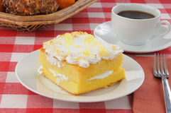 Lemon cake with coffee on a picnic table Royalty Free Stock Images