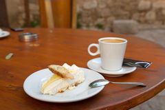 Lemon cake and cup of coffee Royalty Free Stock Photos
