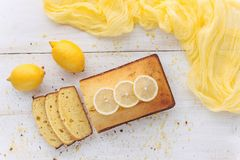 Lemon cake with fruits on white wooden surface Stock Images
