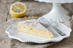 Lemon cake. Homemade lemon cake with cream and fresh lemon, selective focus Stock Photo