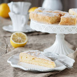 Lemon cake. Homemade lemon cake with cream and fresh lemon, selective focus and square image Stock Photography