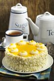 Lemon cake. And cup of tea on table Royalty Free Stock Photos