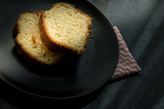 Lemon Cake served in a black plate. Royalty Free Stock Photos