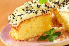 Lemon cake. Sponge cake with lemon buttercream frosting royalty free stock images