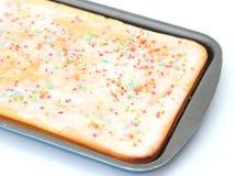 Lemon cake with sugar sprinkles. Isolated on white background royalty free stock images