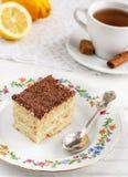 Lemon cake and tea. On a beautiful plate royalty free stock photo