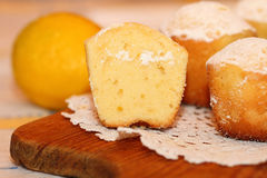 Lemon cakes. The lemon cakes served on a lacy napkin Stock Image