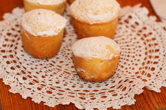 Lemon cakes. The lemon cakes served on a lacy napkin Royalty Free Stock Image