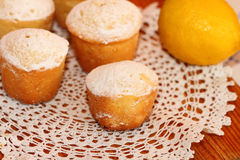 Lemon cakes. The lemon cakes served on a lacy napkin Stock Photography