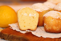 Lemon cakes. The lemon cakes served on a lacy napkin Royalty Free Stock Images