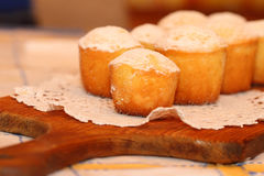 Lemon cakes. The lemon cakes served on a lacy napkin Stock Images