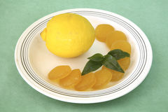 Lemon with candies Royalty Free Stock Image