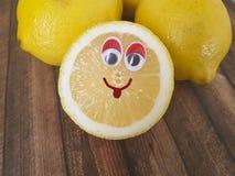 Lemon cartoon on a wooden