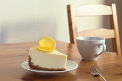 Lemon cheesecake and cup of coffee Stock Images