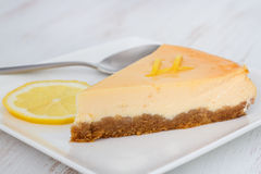 Lemon cheesecake on the plate. With lemon Royalty Free Stock Photo