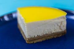 Lemon cheesecake slice on blue plate. Tasty lemon cheesecake on blue plate royalty free stock photography