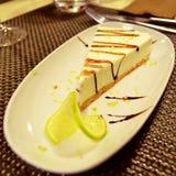 Lemon cheesecake slice Stock Images