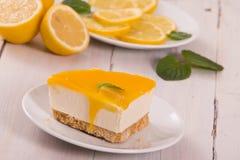 Lemon cheesecake. Lemon cheesecake on white dish royalty free stock photo