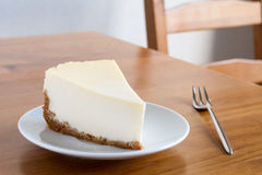 Lemon cheesecake on white plate, breakfast table Stock Images