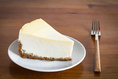 Lemon cheesecake on white plate, breakfast table Stock Image