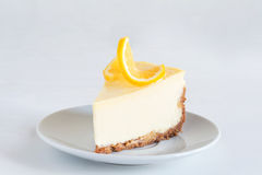 Lemon cheesecake on white plate Royalty Free Stock Photography