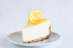 Lemon cheesecake on white plate Royalty Free Stock Image