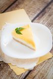 Lemon cheesecake on a white plate. With yellow paper napkins Stock Photography