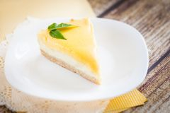 Lemon cheesecake on a white plate. With yellow paper napkins Royalty Free Stock Images