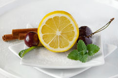 Lemon and cheries Royalty Free Stock Image