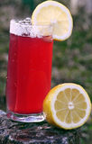 Lemon and cherries drink Royalty Free Stock Photos