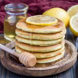 Lemon and chia seed pancakes served with honey, square royalty free stock photography