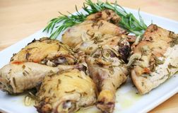 Lemon Chicken. Marinated Lemon Chicken on White Plate Royalty Free Stock Photography