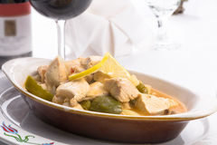 Lemon Chicken Complimented with Red Wine Royalty Free Stock Photo