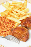 Lemon chicken fries and beans meal Royalty Free Stock Photography