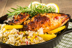 Lemon chicken with rice and roasted corn Stock Photos